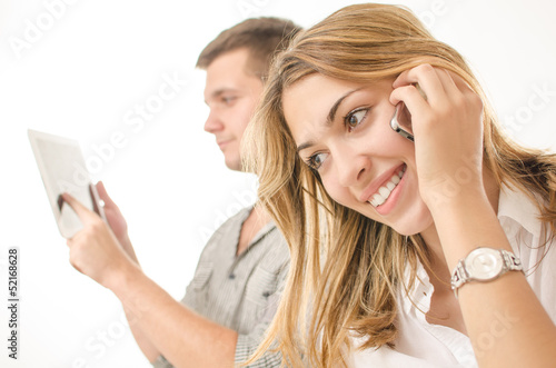 business couple using phone and tablet