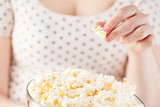 Girl holding a glass bowl of popcorn