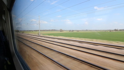 Travelling by train in the UK. Sunny spring day.