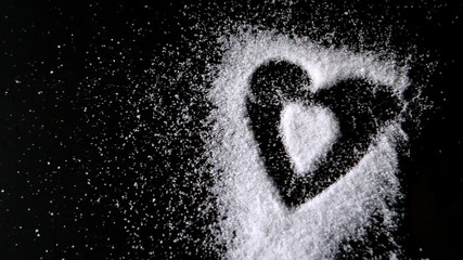 Heart design shaped out in sugar blowing away