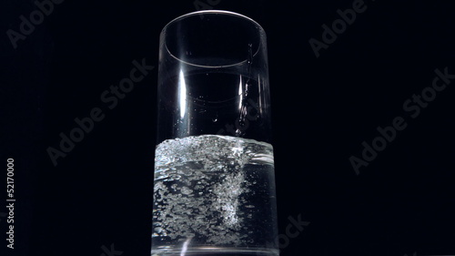 Low angle view of water pouring into glass