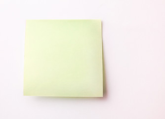 Blank Sticky Note on white wall