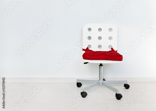 White chair against wall