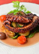 Fresh grilled octopus with olives, potato, tomatoes