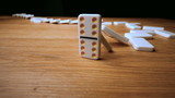The domino effect on wooden table