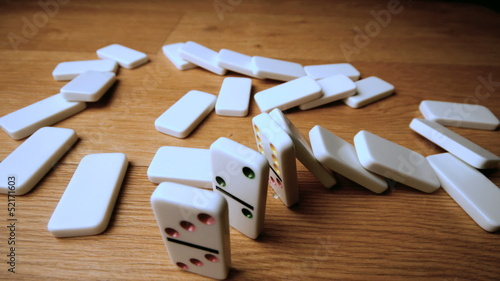 The domino effect on wooden table high angle shot
