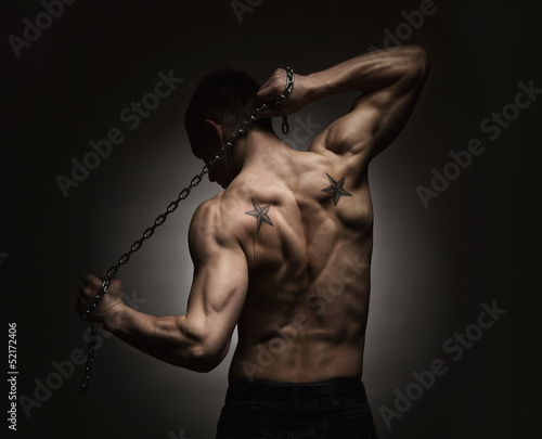 Athlete stretching out over dark background