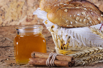 Honey and fresh bread and cinnamon on the table
