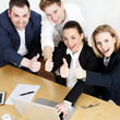 Successful business people are in a meeting show thumbs up