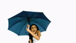Pretty woman under blue umbrella cowering with fear