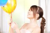 happy teenage girl with balloons