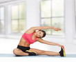 Sporty Woman Doing Exercise On...