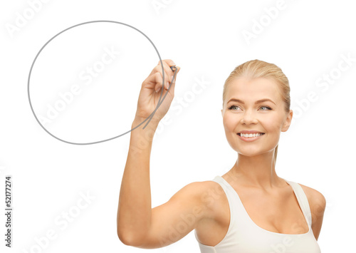 woman drawing round shape