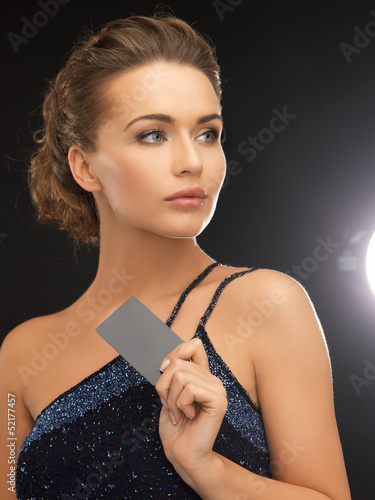 woman in evening dress with plastic card