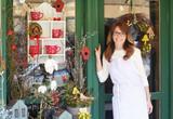 Smiling Mature Woman Florist  At Flower Shop - Fine Art prints