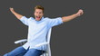 Man on swivel chair raising arms to show his succes