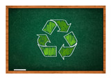 recycle symbol on green chalkboard