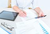 Fototapety Business person analyzing statistics