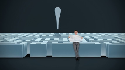 Businessman with Map trying to find his way in a Maze