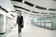 canvas print picture - business man walking in subway