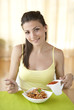 Young happy woman eating italian pasta