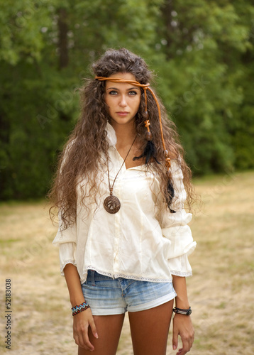 Beautiful hippie girl in the park