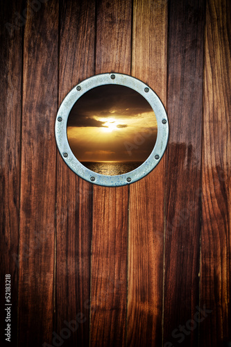 Boat porthole with ocean view