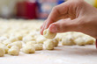 Hand preparing homemade italian gnocchi