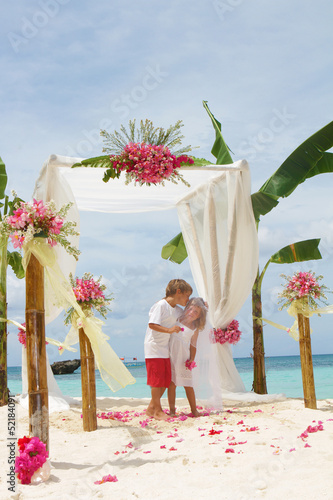 young loving couple on wedding day in beautiful wedding setup wi