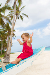 outdoor portrait of happy baby child on board of sea boat
