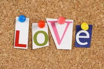The word Love in cut out magazine letters