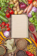 Assortment of vegetables and blank recipe book