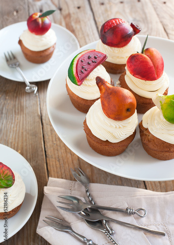 Cupcakes with vanilla buttercream and marzipan fruits