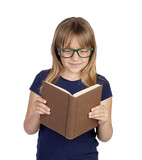 Beautiful little student with glasses reading a book