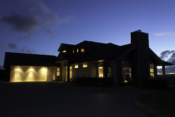 Modern house exterior with lighting at night
