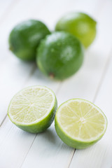 Fruits: fresh ripe limes on wooden boards