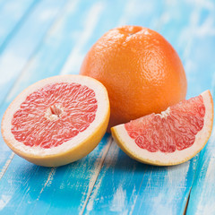 Close-up of ripe grapefruit and its segments on wooden boards