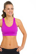 Smiling fitness young woman looking on copy space