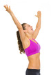 Happy fitness young woman rejoicing success