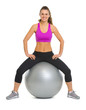 Portrait of smiling fitness young woman on fitness ball