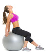 Fitness young woman on fitness ball making exercise