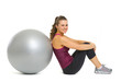 Smiling fitness young woman sitting near fitness ball