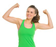Happy fitness young woman showing biceps