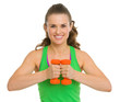 Portrait of happy fitness young woman with dumbbells