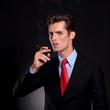 business man prepares to smoke