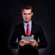 business man holds tablet