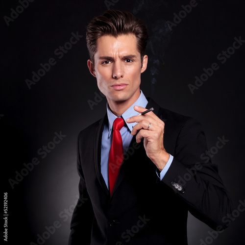 business man holds cigarette