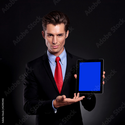 business man presents tablet