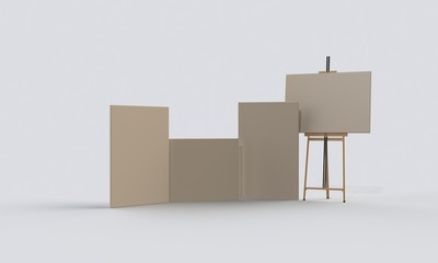 easel and canvas boards on the floor