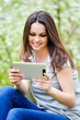 Young happy smiling woman working on pda tablet